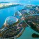 A wide perspective view of ships moored and botanical garden from the roof top of Marina Bay Sand Hotel in Singapore