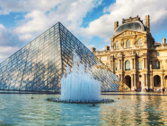 PARIS - OCTOBER 9: The Louvre Pyramid on October 9, 2014 in Paris, France. It serves as the main entrance to the Louvre Museum. Completed in 1989 it has become a landmark of Paris.