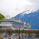 SKAGWAY, USA-May 22: Cruise ships at Skagway harbor, bringing tourists from all over the world to Skagway, the town where the historical Klondike gold rush started, May 22, 2012, Skagway, Alaska, USA