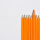 Isolated shot of outstanding pencil on white background
