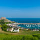 Harbour and Gorey Castle in Saint Martin, Jersey, Channel Islands, UK on summer day.